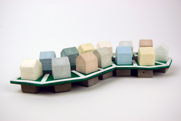 "It's a Great Neighborhood,  cast plastic, spray paint, flocking, concrete, copper, brass, acrylic sheet, 1¾"" x 5"" x 10"", 2013"
