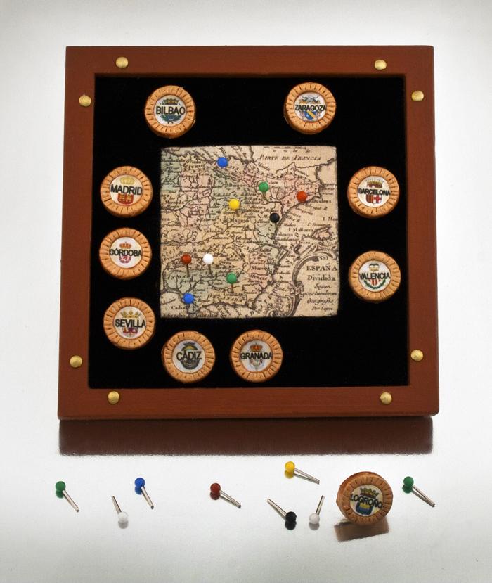 "Pinned,  resin, map pins, map of Spain, velvet, cork, wood, brass, copper 3½"" x 3½"" x ½"", 2010"