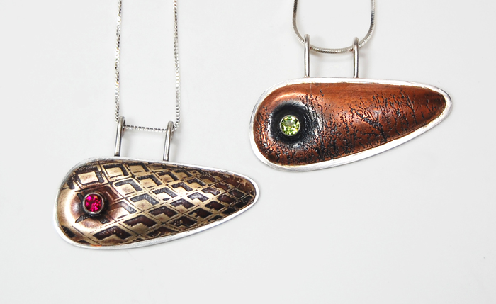 """Commissioned  Pillow  pendants, sterling silver, brass, copper, ruby, peridot, ¾"""" x 1¾"""", 2011"""