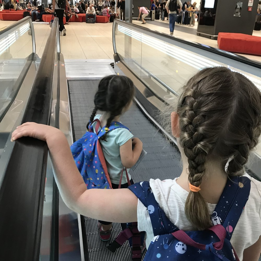 Enjoying the moving sidewalk at FCO airport in Rome