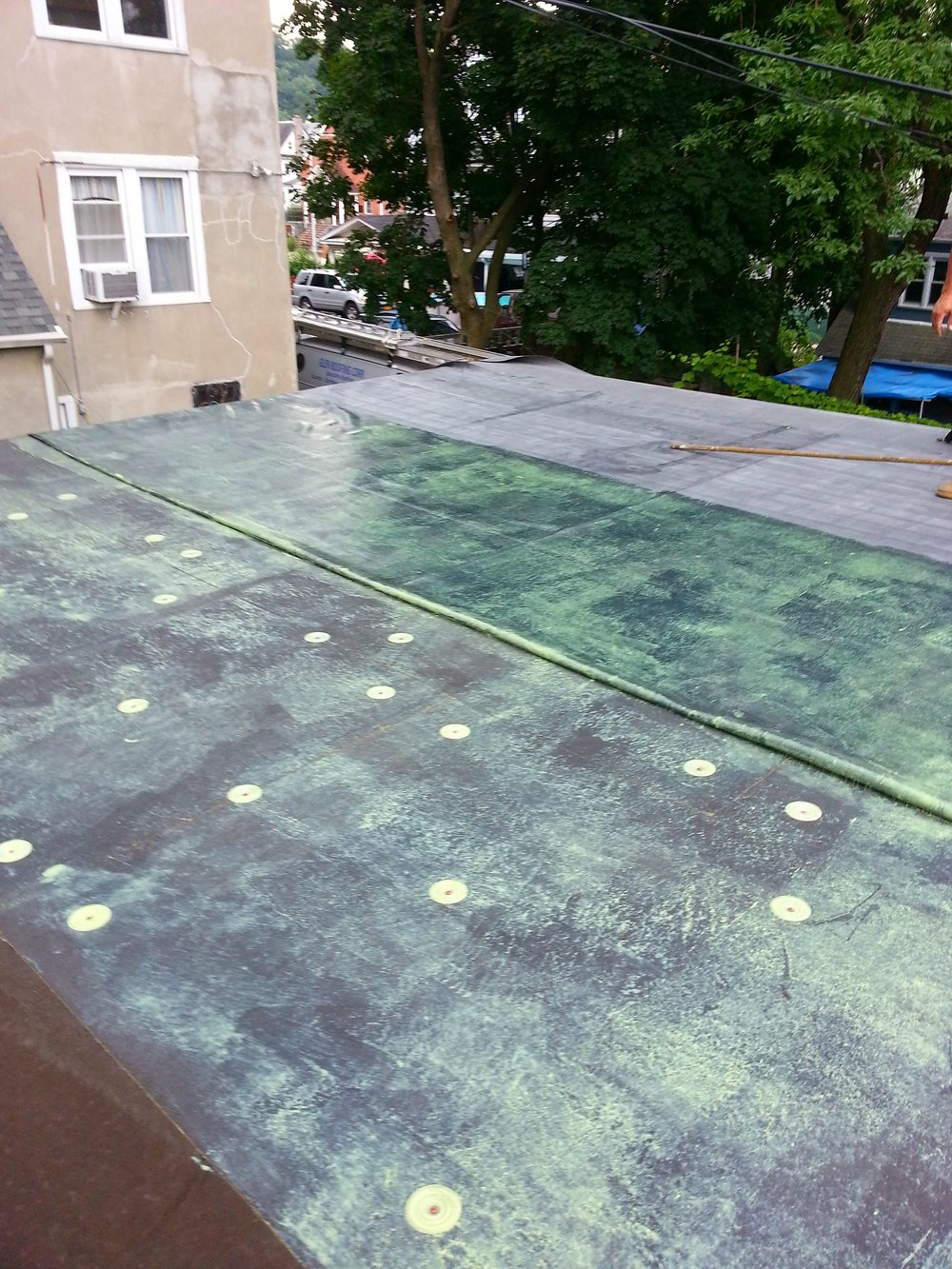 Flat Roof EPDM Installation - Bonding Adhesive