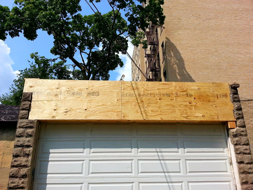 Plywood Cover for Garage Reconstruction
