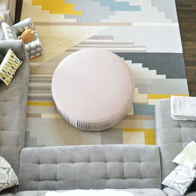 "You guys... I am so in love with my new ottoman.  Here's an aerial view of my living room.  The color of the ottoman is so subtle that it should be called barely pink.  I mentioned in an earlier post that this ottoman is on sale @westelm !  Because it would be considered a final sale, I was afraid to buy it without seeing it in person or seeing more ""real people"" photos of it.  Now that I actually bought it, I decided to post on my blog some photos of how it looks in my living room from different angles in natural light.  Hope that this will help someone who is looking to buy this beautiful piece!  Check out the latest post on my blog in bio! . . . . .  #westelm #mywestelm #roundottoman #ottomans #homefurnishings #livingroomdecor #livingroominspo #livingroomfurniture #interiorinspo #furnitureideas #interiorinspiration #interiordesignblogger #colorfuldecor #colorfulhome #furnituredeals #interior_design #homedetails #homeideas #sofatable #interiors123 #homedesigning #qualityfurniture"