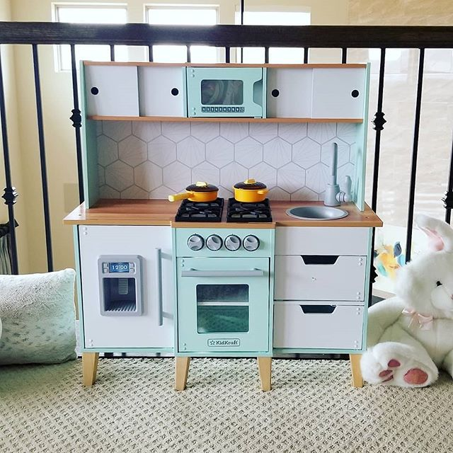 So I don't cook.  My friends ask me what I even use my kitchen for if I don't ever cook... lol.  BUT I bought this little play kitchen for my daughter for Christmas, and I use it ALL THE TIME!! It's so tiny and cute and no (real) mess.  I bought plastic fruits and veggies where they're velcro'd together in the center, so you can pretend to cut veggies and it'll split in half!  Too cool.  I realize this doesn't mean I cook now, and I'm not sure what the point of this post was besides letting you know that I think I enjoy this play kitchen more than my daughter does.  No judging. . . . . .  #kidsinteriordesign #nurserydecor #playkitchen #kidskitchen #babyroomideas #kidsinteriors #childrensroom #kidsroominterior #childrensinteriors #childrensdecor #kidsinterior #babyroomdecor #kidsplayroom #babyplayroom #playroominspo #interiorforkids #playroomdecor #kids_interior1 #kidsperation #kidsroominspo #mytargetstyle