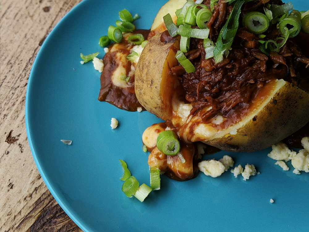 The Carolina baked potato poutine: pulled beef, spring onions and cheese curds.