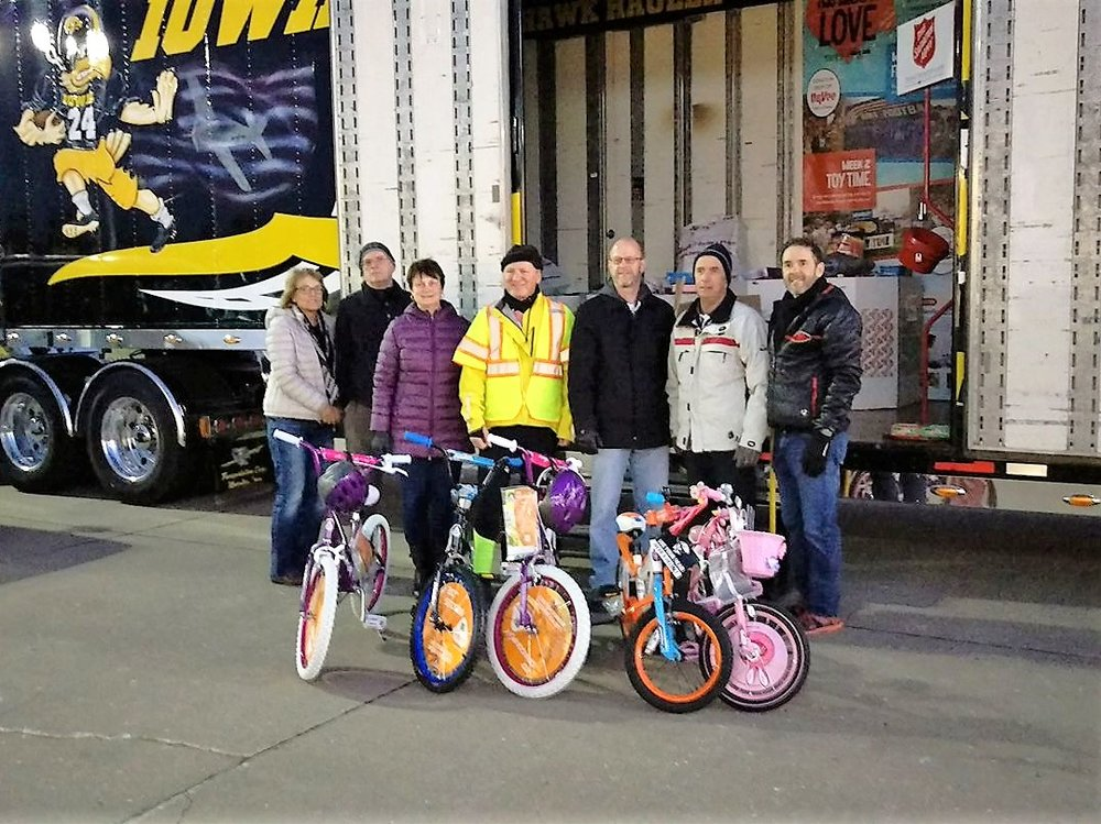 Melon City Bike Club members donating helmets and bikes to the Salvation Army Toy Time, December 2017