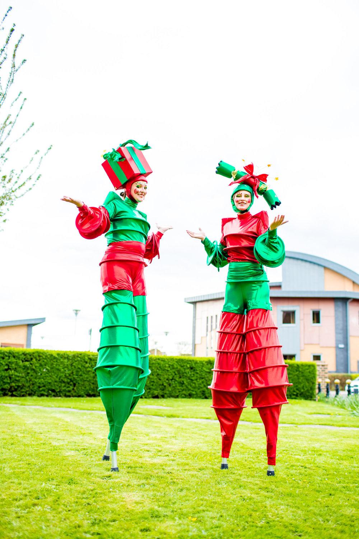 The Christmas Stilt Walkers Talking.jpg