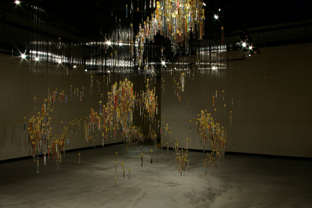 Sara Young (American, born 1960) and Tyler Budge (American, born 1972).  Why be/e collective , 2005. Mixed media, glass test tubes, monofilament, audio, dymno label tape; Variable dimensions. Collection of the artists. Photo courtesy of the artists.