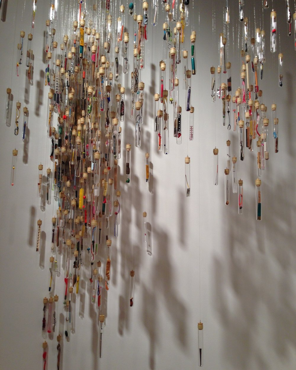 Sara Young (American, born 1960) and Tyler Budge (American, born 1972).  Swarm , 2005. Mixed media, glass test tubes, monofilament, audio, dymno label tape; Variable dimensions. Collection of the artists. Photo courtesy of the artists.
