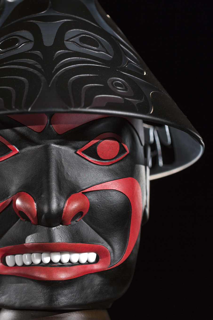 Preston Singletary (American Tlingit, born 1963). Realm, Air – Raven Clan Figure  (detail) ,  2017.Blown and sand-carved glass;26 1/2 × 13 × 12 in. Courtesy of the artist. Image courtesy of Russell Johnson.