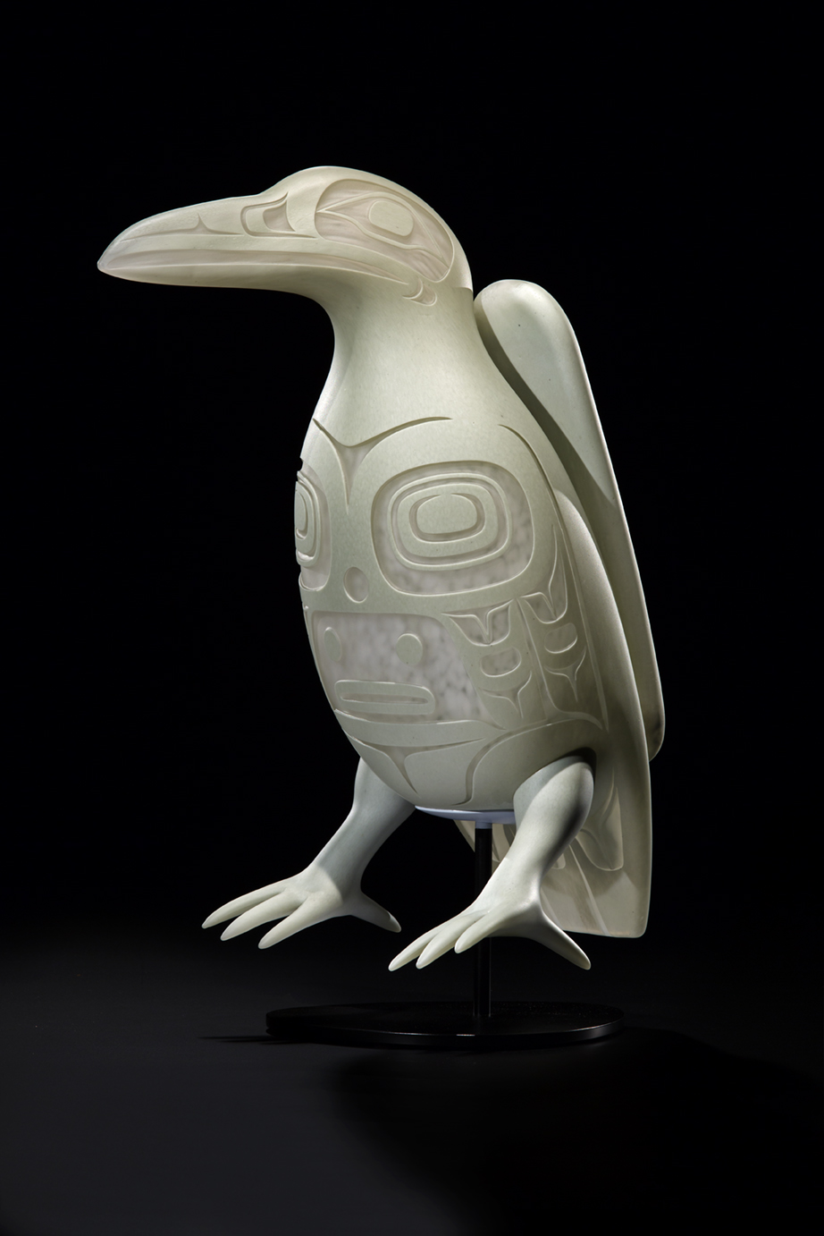 Preston Singletary (American Tlingit, born 1963).  White Raven,  2017. Blown, hot-sculpted, and sand-carved glass; steel stand; 18 1/2 × 7 × 9 in. Courtesy of the artist. Image courtesy of Russell Johnson.