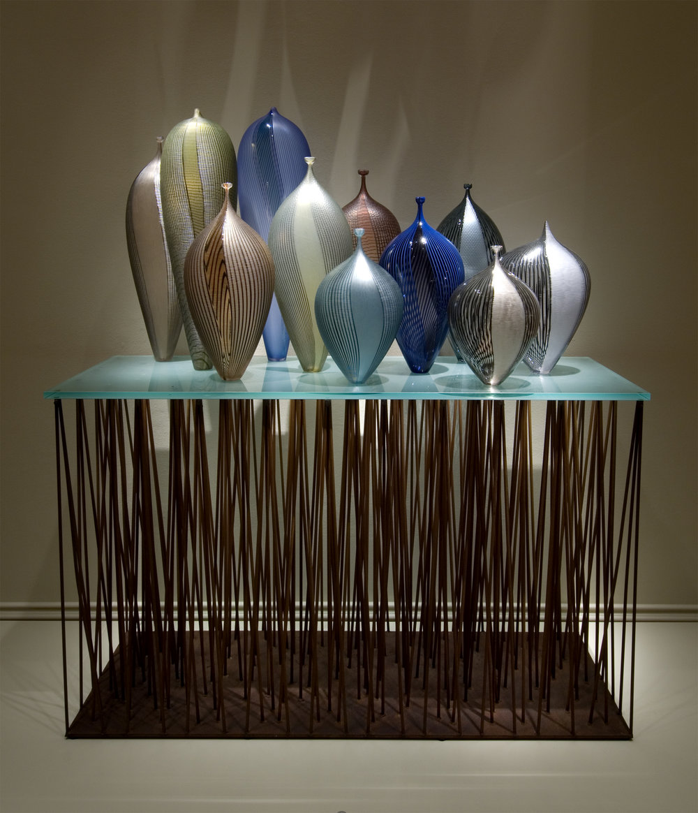 Lino Tagliapietra (Italian, born 1934).  Manhattan Sunset,  1997. Blown glass with canepick-ups,  battuto  and  inciso  cut; steel and glass base; 67 x 60 x 20 in. Collection of Museum of Glass, Tacoma, Washington. Photo courtesy of the Smithsonian American Art Museum.