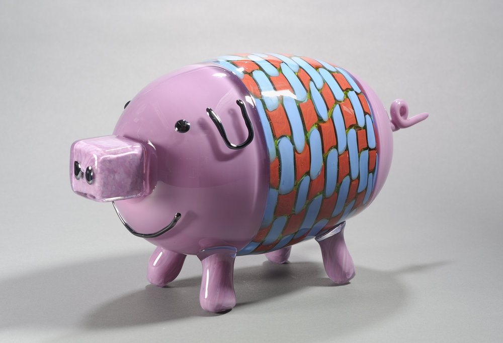 Designed by Forrest Brennan (age 10), made by Museum of Glass Hot Shop Team.  Pig in a blanket,  2010. Blown and hot-sculpted glass; 8 1/4 x 15 x 6 in. Collection of Museum of Glass, Tacoma, Washington. Photo by Duncan Price.