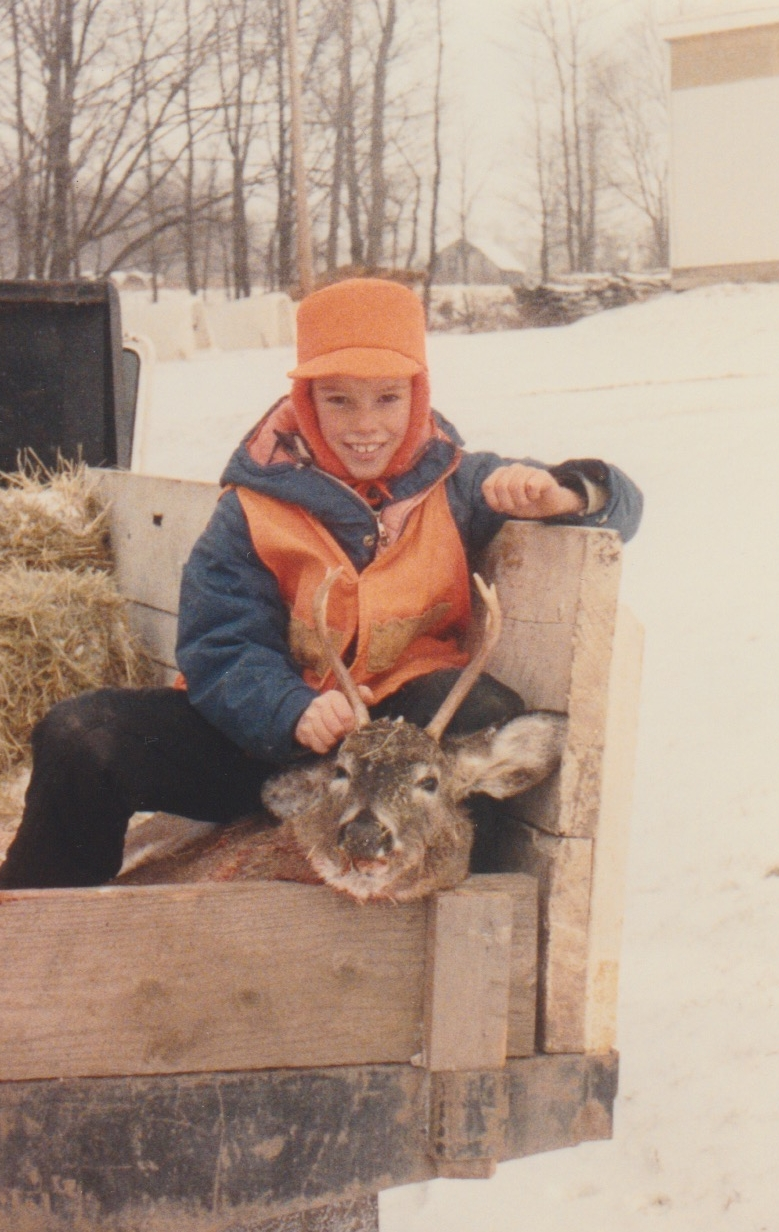 Clint Owlett as a child, with his trophy