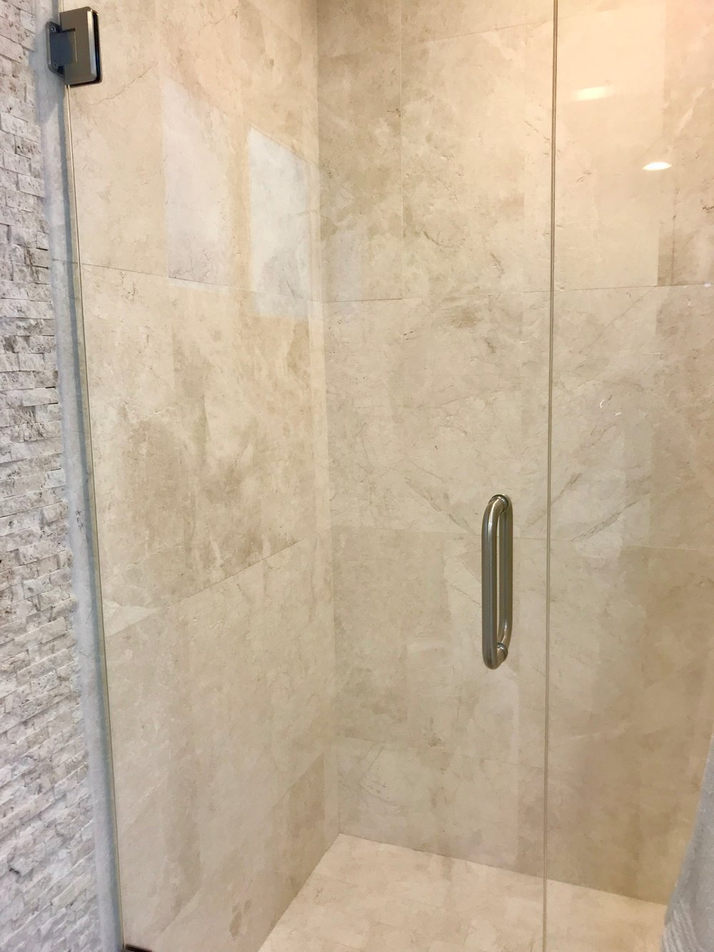 Master bath shower with three dimensional tile.