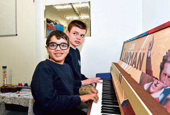 Orchard Brae kids enjoy the piano. Credit: Evening Express.