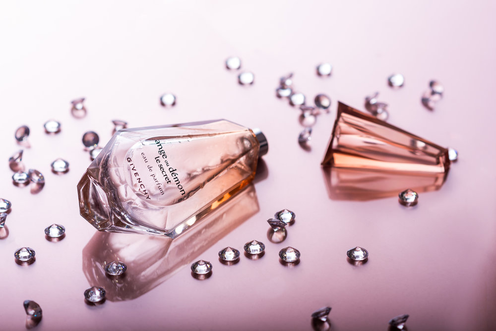 A stylised product shot associating perfume with diamonds