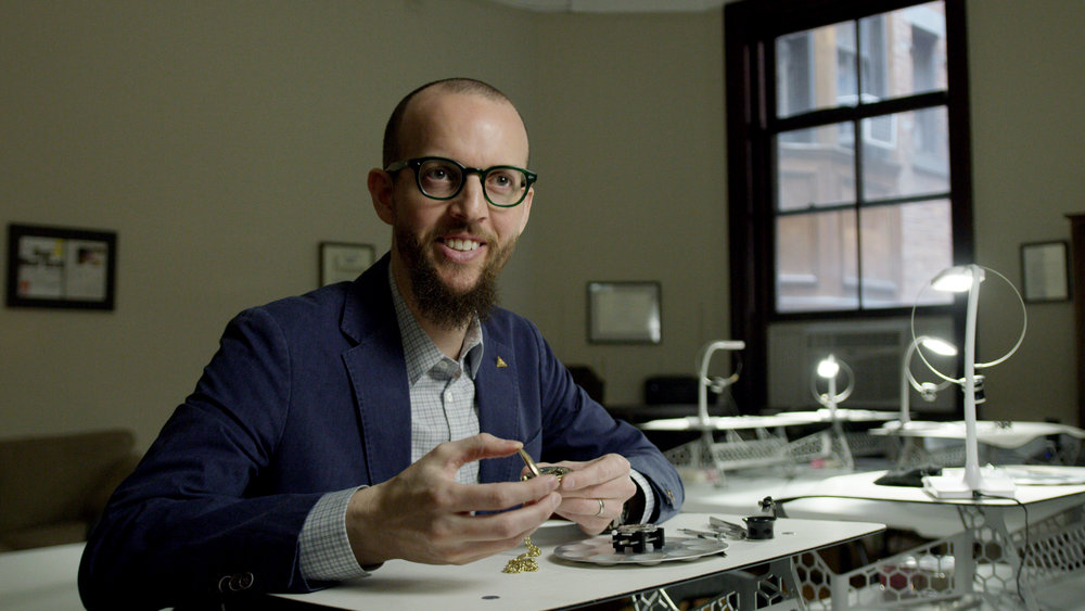 Nicholas Manousos  is a watchmaker, co-founder of Firehouse Horology, President of the Horological Society of New York, Technical Editor for Hodinkee.com and Horological Consultant for this film.