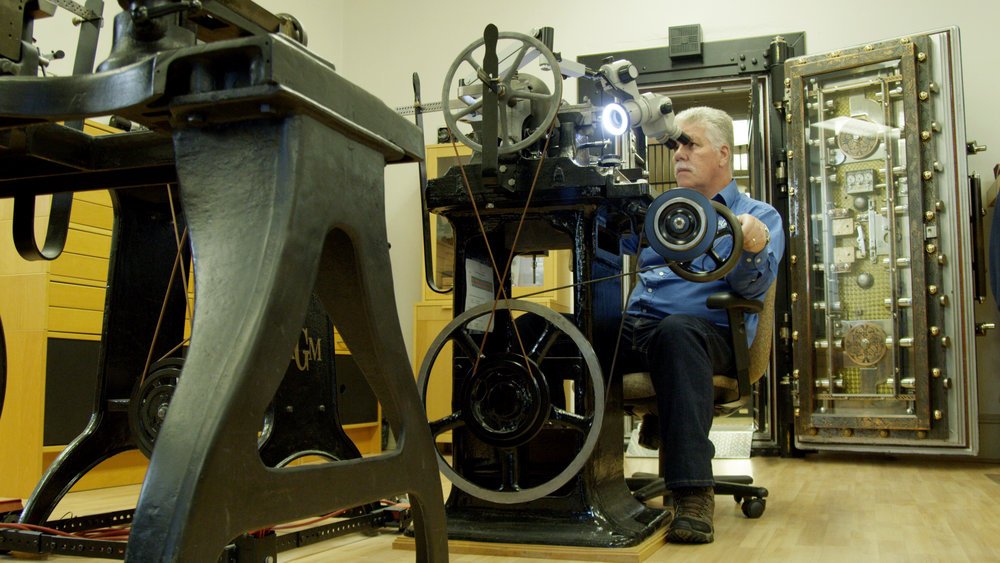 Roland Murphy behind the wheel of one of his antique rose engines.