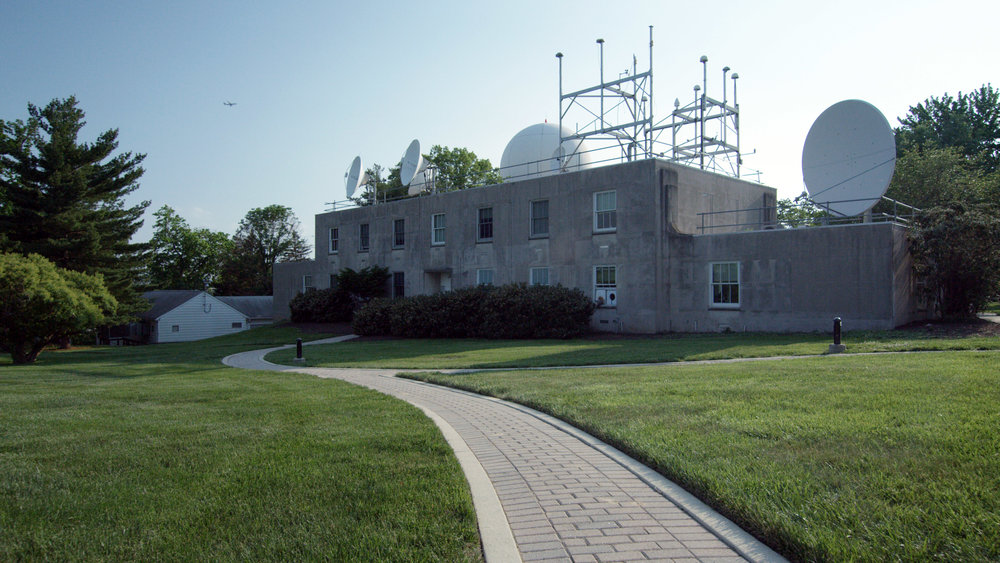The Time Service building on the grounds of the U.S. Naval Observatory houses the atomic clocks that generate time for accurate GPS navigation.