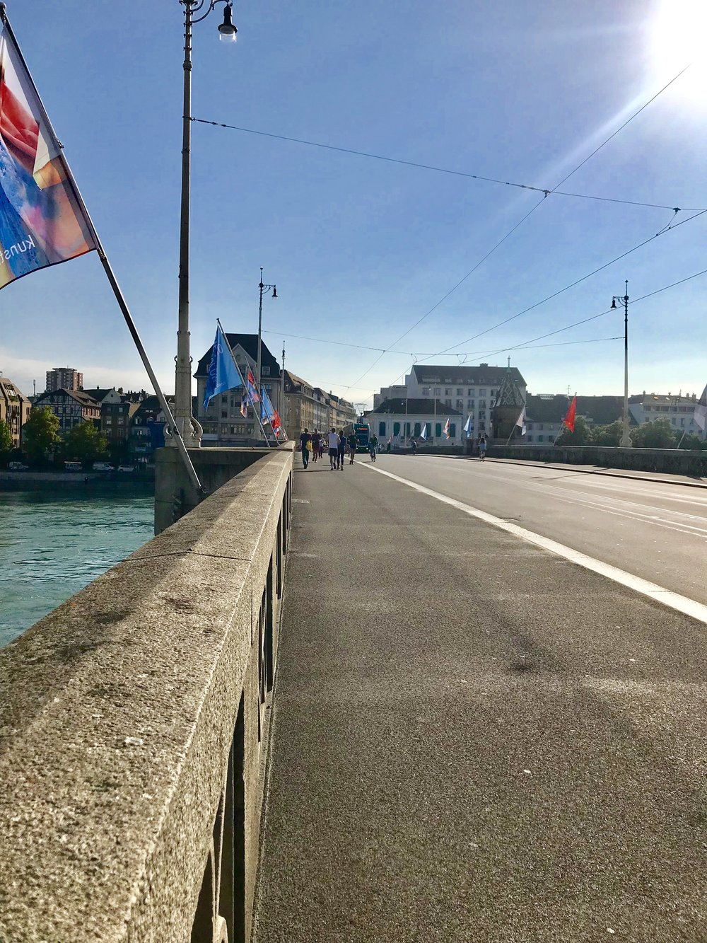 Strolls across the bridge, Basel. Photo: Naomi Tsvirko