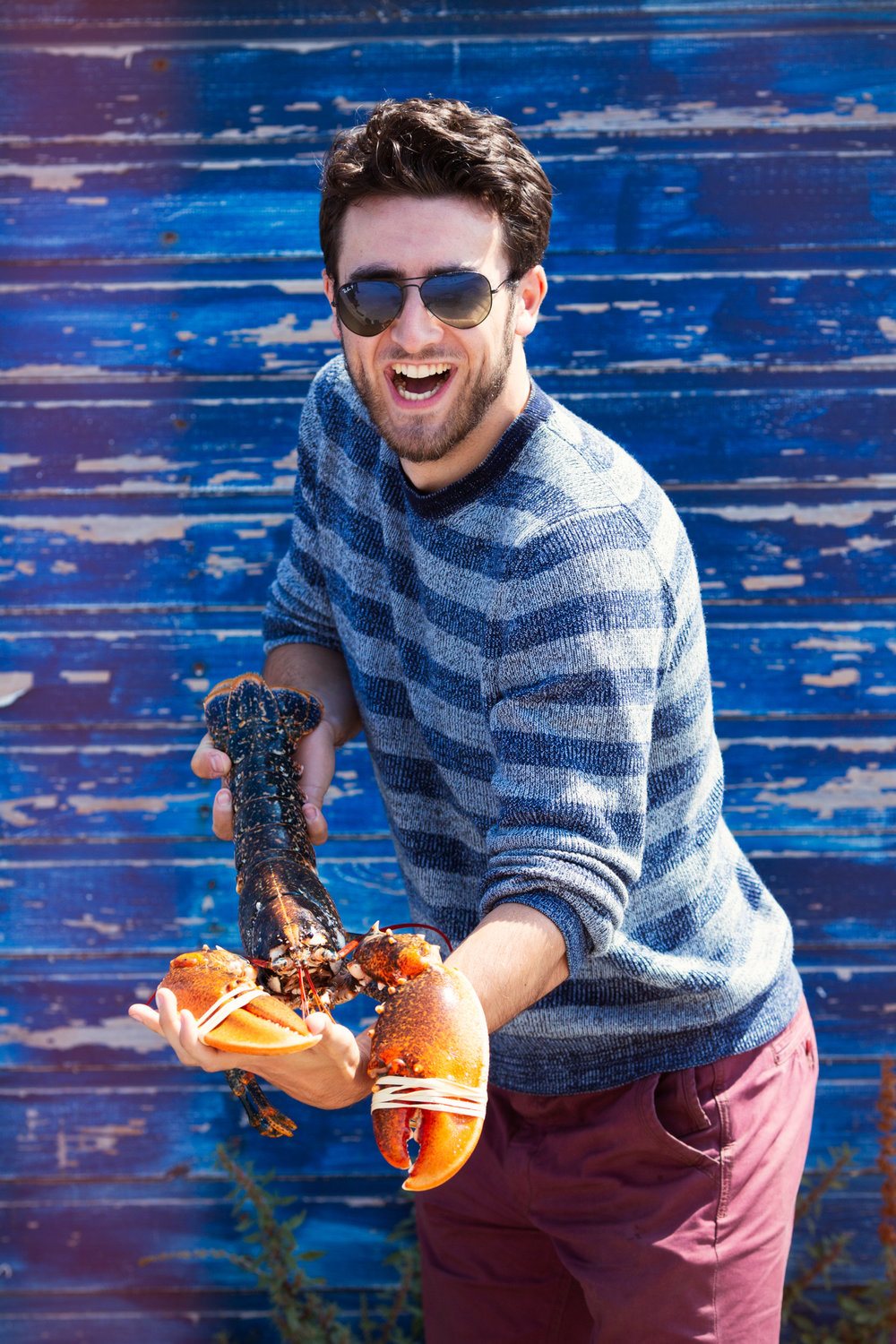 Isaac getting to grips with a lively lobster.