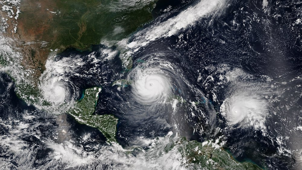Satellite image of three active hurricanes  Katia ,  Irma  and  Jose  threatening land simultaneously on 8 September 2017