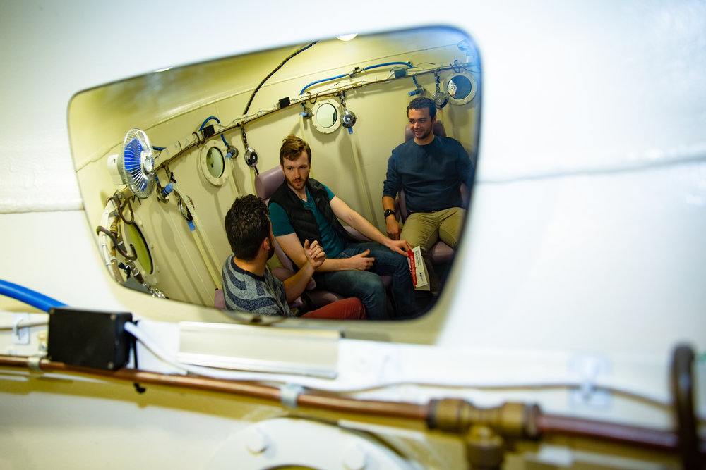 Ben, Jack and Isaac pictured here in the walk-in oxygen chamber at the Centre. An hour of oxygen is delivered to BMSTC members at higher pressure to speed up oxygen absorption into the blood stream.