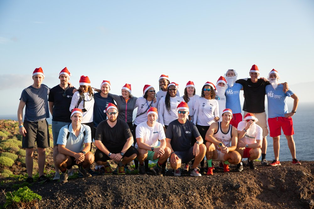 Two dozen Hot Santa's watched the sunrise and then walked to the lighthouse to show solidarity for Atlantic Discovery's commitment to a world free of MS.