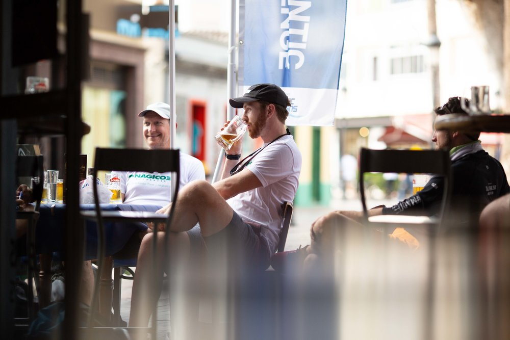 Atlantic Discovery  enjoying one of their final cold beers before the start of their row in the shade outside the Blue Marlin Taberna.
