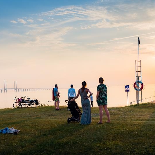 3. Sibbarp - Another perfect spot for gatherings is Sibbarp beach overlooking the iconic Øresund Bridge, which links Sweden with Denmark. It's a long beach with lots of greenery and piers. This is where we meet friends for relaxed picnics and sometimes a little swim during the summer months. malmo.com/placesofinterest/beaches