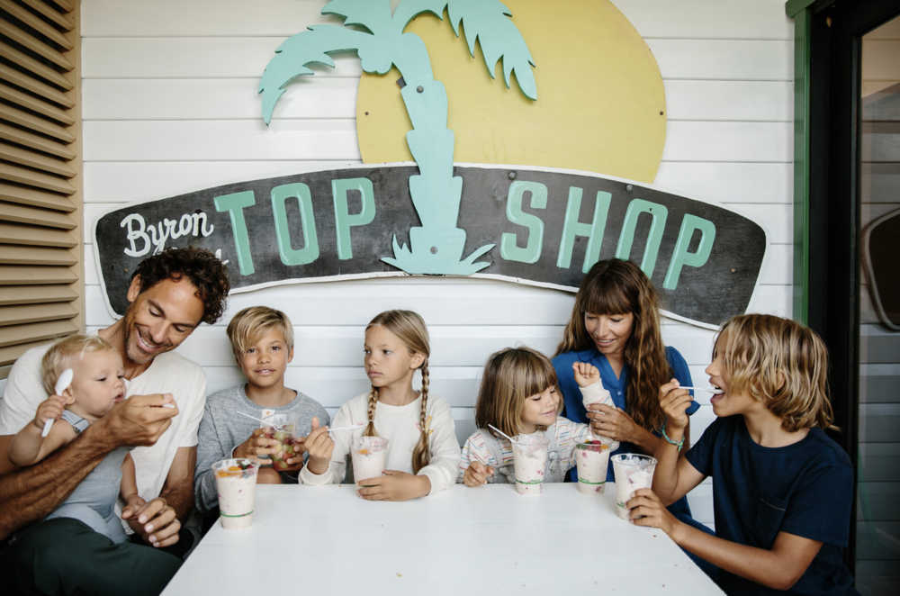 The Adamo family, left to right; Wilkie, Michael, Easton, Ivy, Marlow, Courtney and Quin at TopShop, Bryon Bay. Photo: Amelia Fullarton.