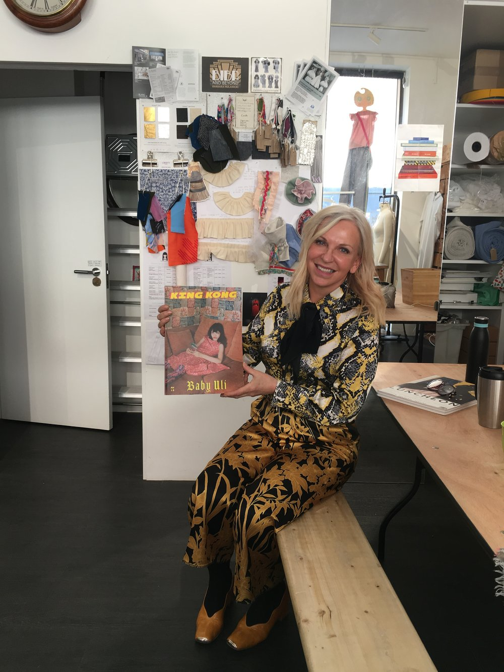 The Fashion School founder Caroline Gration holding up a copy of King Kong featuring work from the school.