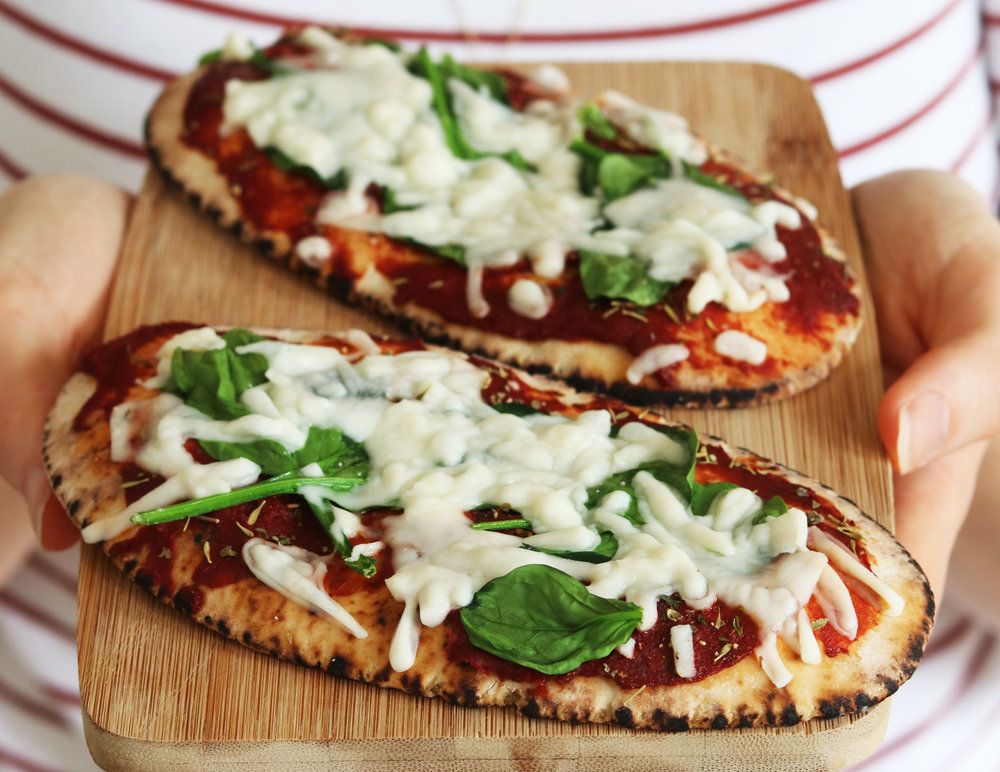 The easiest and quickest way to make pizzas, is with pittas! - prep time5 mins  total time10 mins serves 1