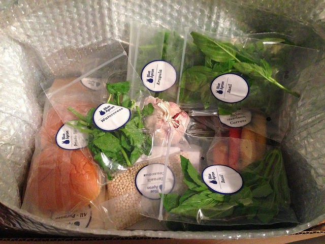 This is how your Blue Apron box arrives, with a dozen tiny ziploc bags, all well labeled for easy identification.