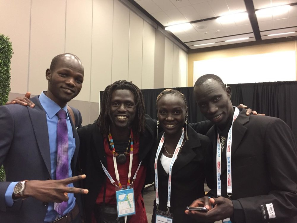 James Madhier with members of the Refugee Olympic Team at One Young World in Ottawa.