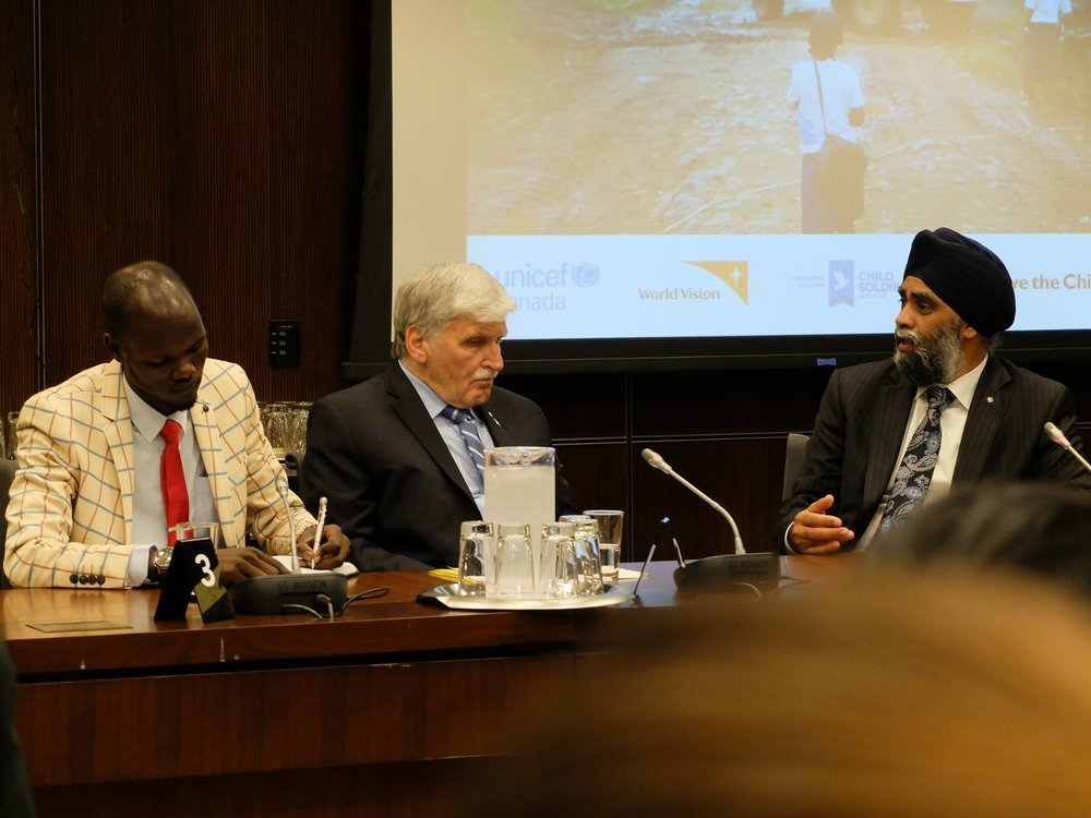 James Madhier speaking with Lt. Gen. Roméo Dallaire, Canadian Defense Minister Harjit Sajjan, and CBC's Carol Off on preventing the use of child soldiers in war.