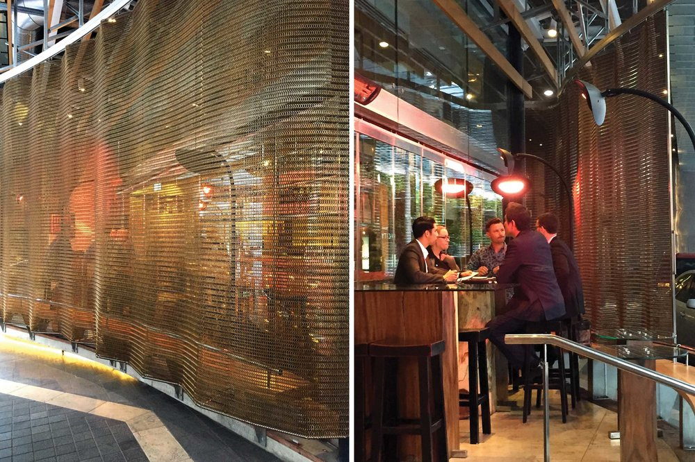 Masu Restaurant, Sky City Grand Hotel Folding Screens   The Bronze Kaynemaile mesh screens surrounding Masu restaurant in the prestigious Sky City Grand Hotel in Auckland separate the outside bar area of the restaurant from the hotel's drop-off point. The screens act as a stunning spacial divider to this stunning restaurant.