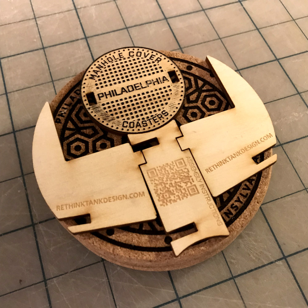 STEP one - REMOVE SLOTTED RACK PIECES FROM COASTER PACKAGE. NOTE THE ORIENTATION OF THE ELEMENTS. KEEP THE TEXT PORTIONS FACING OUTWARD WHEN ASSEMBLING.