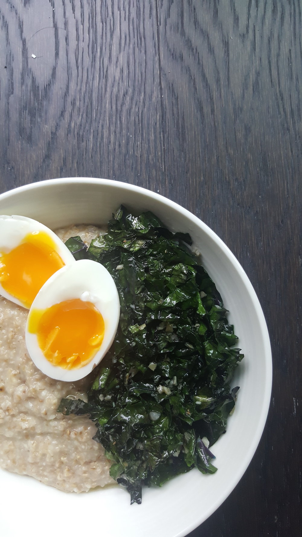 - ingredients-1/2 cup oats-1 cup water-1 tbsp sharp cheddar cheese-organic if possible (parmesan also works well)-1 clove garlic, minced-2 tsp butter- organic if possible; or 2 tsp coconut oil-2 cup chopped kale- about 2-3 large leaves-1 egg (I went with medium boiled)-pinch of s&p make i-begin by making the egg: add the egg to a small saucepan and cover with water, bring the water to a boil. As soon as the water starts to boil, set your timer for 5 minutes. After 5 minutes has passed, cover the egg in cold water and set aside. Once cool enough to handle, you can peel your egg and set it aside until it's time to eat. Note: this is how I like to prepare my eggs, 5 minutes is the perfect amount of time to cook the whites but leave the yolk still runny. Feel free to cook your egg any way that you prefer.-to prepare the oatmeal: bring water to boil in a small sauce pan, add the oats and give it a good stir. Turn the heat down to low, until the oatmeal is just slightly bubbling. Allow the oatmeal to cook, stirring every few minutes. Continue to watch it and remove from the heat when the oats are cooked and still slightly runny.-while the oatmeal is cooking, pre-heat a skillet on medium heat, add the butter or coconut oil to melt. Prep the kale by removing the thick inner ribbing. Lay the remaining leaves on top of each other and slice into thin ribbons. Once the pan is warm, add the garlic and cook until fragrant. Add the chopped kale and saute until bright green. Sprinkle with salt and pepper and remove from the heat.-once the oatmeal is cooked, remove from the heat and season with a pinch of salt and pepper. Add the cheese and stir until well combined.-pour the oatmeal into a bowl and top with the kale. Slice the egg in half and add it to the bowl. Serve immediately and enjoy!