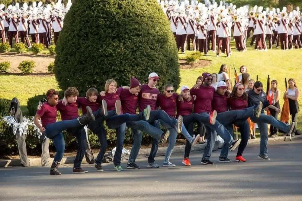 Courtney and fellow managers doing the Hokie Pokie; Source: Facebook
