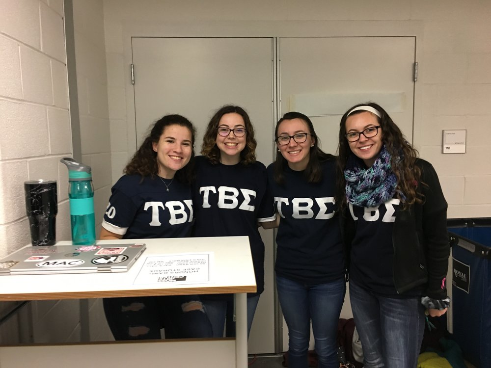 Members of Tau Beta Sigma assisting with Honor Band (from left to right: Lexie Hackman, Kaelyn Knott, Karen Small, Alison Ritz); Source: Alana Hassett