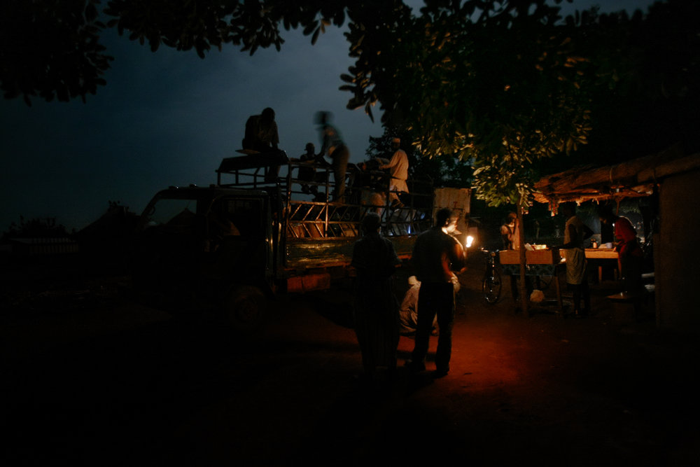 People board the last car of the night through Wantugu, Northern Region, Ghana on June 27, 2007.