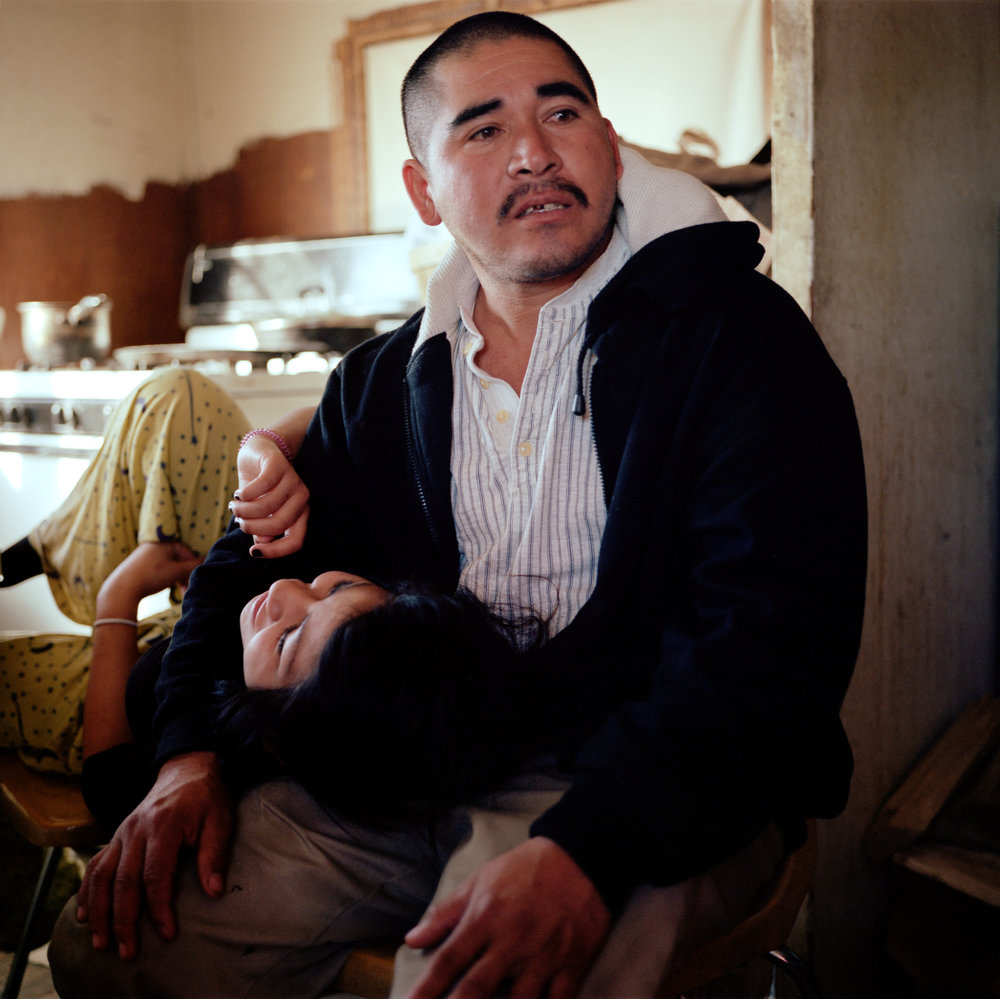 Isidro Alcudia and his teenage daughter, Roxanna, in their home in Pajarito Mesa, New Mexico on Feb. 18, 2011.