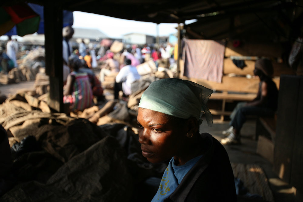 Lamisi sits and waits for work in the yam market in Accra, Ghana on Feb. 11, 2009.