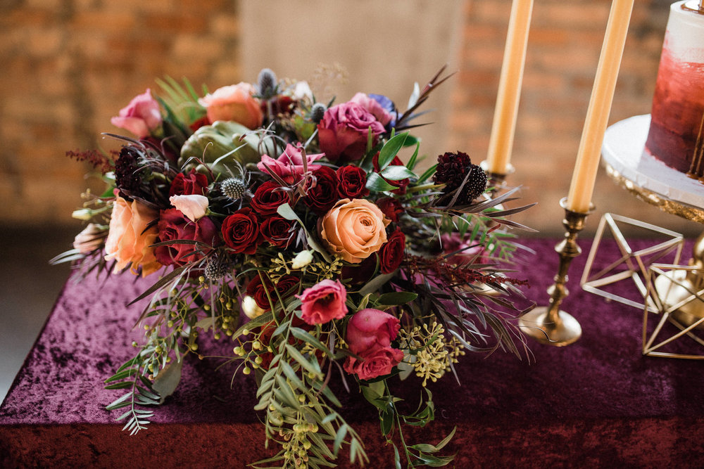 Flower arrangements by The Flower Man, decor from Something Old Dayton, planned and styled by Perry Rose Media, and photographed by Chelsea Hall
