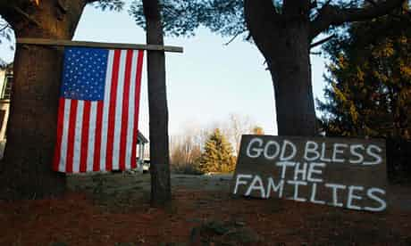 A sign and a US national flag are seen near Sandy Hook elementary school. Photograph: Eric Thayer/Reuters