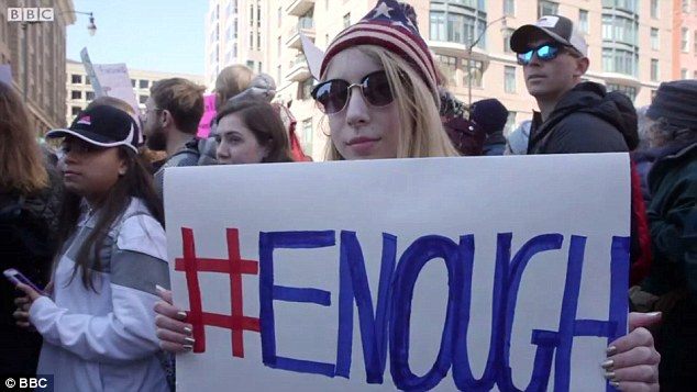 Lauren, Dalton, and their parents boarded a bus from Newtown at 5am to reach the rally, carrying signs that read 'Enough'
