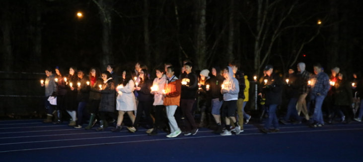 Some of the members of Jr NAA led people around the track at Blue & Gold stadium on February 23 as part of the vigil for the community of Parkland, Fla.