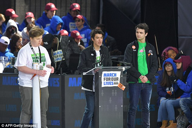 More than 400 people from Newtown attended March For Our Lives in DC, where they heard speeches from Sandy Hook survivor Tommy Murray (center)